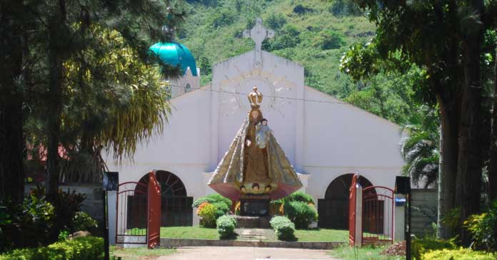 Main entrance to the house with eight foot statute of Mary welcomes pilgrims